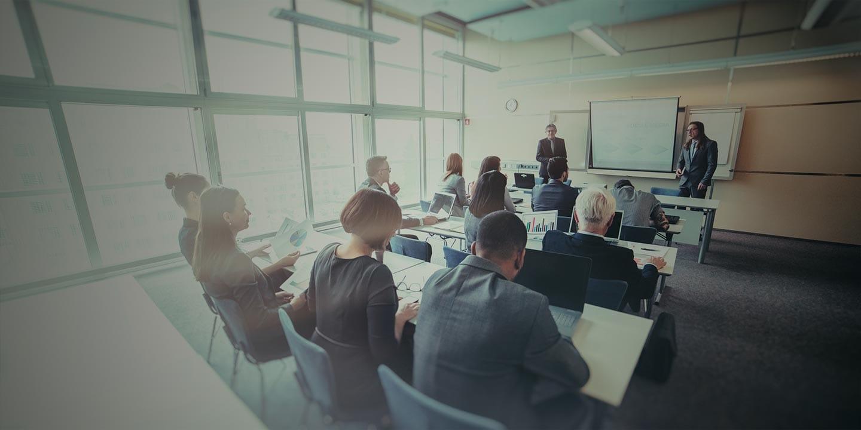 Team meeting in huge meeting room.